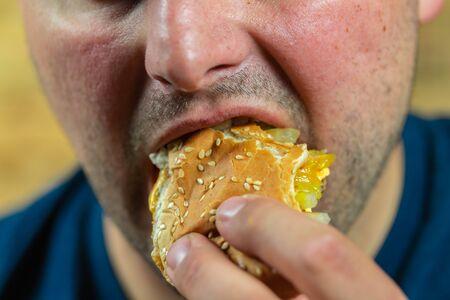 Man enjoying his tasty burger.