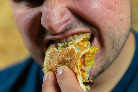Man enjoying his tasty burger.