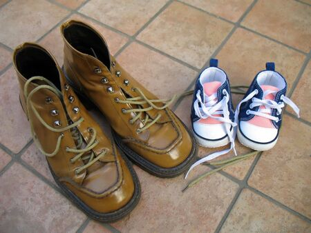 nearness: A pair of shoes for the mother and a pair for the little daughter Stock Photo