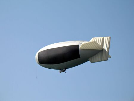 A dirigible airship used as a advertising media for your advertisement