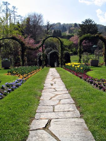 Pathway in a marvellous garden reach of flowers and trees. Lago Maggiore, Italy