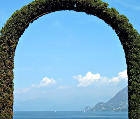 A fence arch-shaped in front of the lake. lago Maggiore, Italy