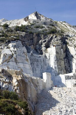 An open quarry of white mable in Carrara, Tuscany, Italy photo