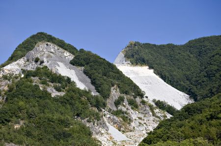 An open quarry of white murble in Carrara, Tuscany, Italy photo