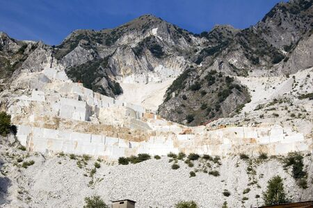 An open quarry of white marble in Carrara, Tuscany, Italy photo