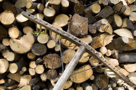 stacked wood logs and rake photo