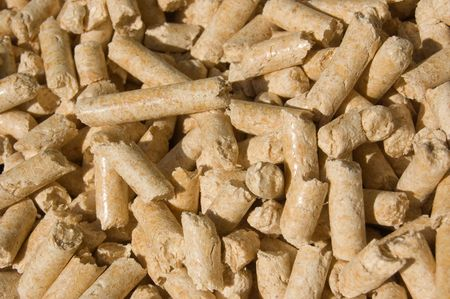 red deal wood pellets green energy close-up Stock Photo