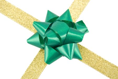 compliment: Christmas decoration golden ribbon with green bow isolated on white