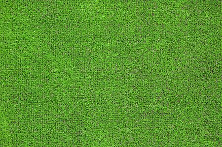 A green artificial grass for sports fields, covering, gardens. Plastic or grass background texture Stock Photo