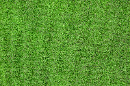 pasto sintetico: Un verde de c�sped artificial para campos de deportes, que abarca, jardines. De pl�stico o de hierba de textura de fondo Foto de archivo
