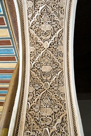 A detail of a Moorish style stucco of an arch in Marrakesh photo