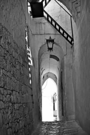Ostuni lane with vaults in the Old Town (the White City), Puglia, Italy