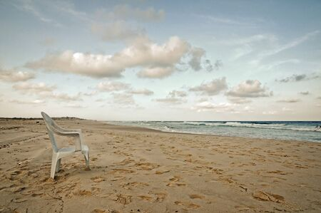 A wonderful tropical beach location with the contrast of abandoned garbage Stock Photo