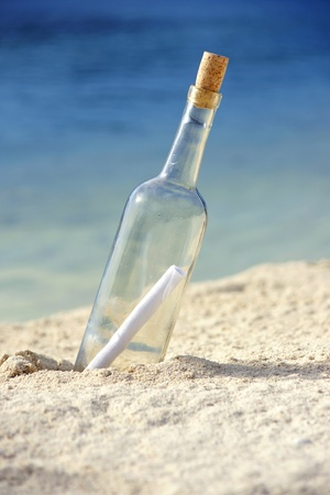 message bottle: Message in a bottle on an isolated beach