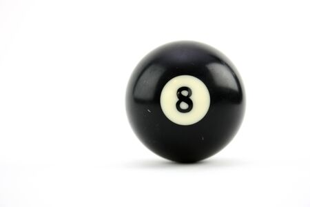 8 ball used in playing a game of billiards