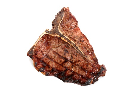 Cooked T-bone steak set on a white background  Stock Photo