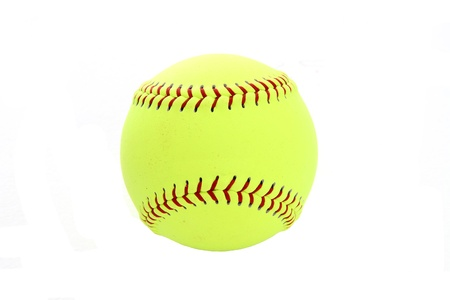 Yellow softball set on a white background photo