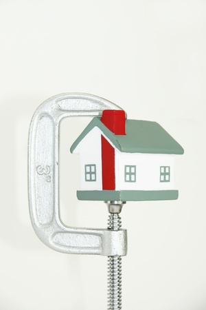 grip: Grip holding a house portraying the housing market