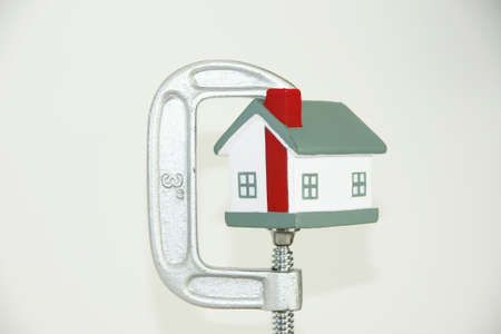 Grip holding a house portraying the housing market Stock Photo - 13139408