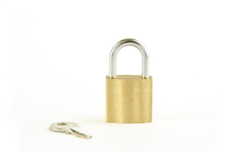 Gold lock set against a white background Stock Photo