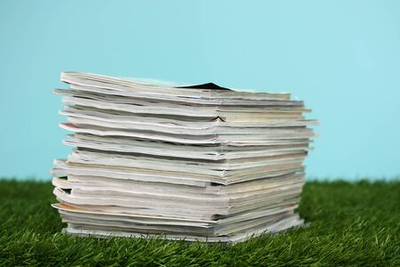 periodical: Stack Of Magazines On Green Grass Outside