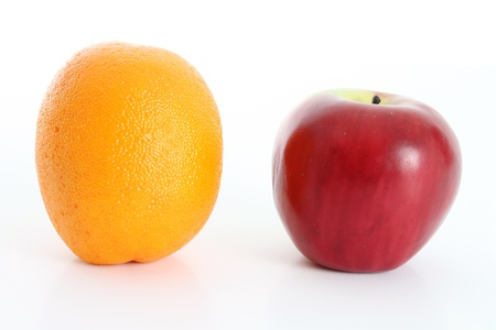Comparing apples to oranges on white background