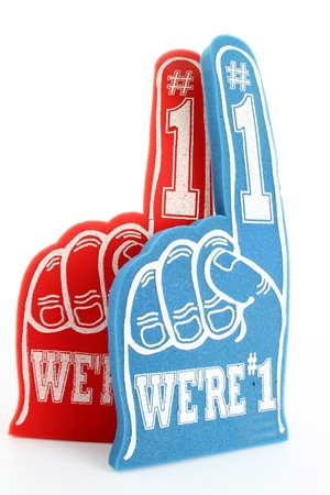 Red and blue foam fingers on white background photo