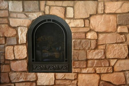 gas fireplace: Fireplace set in a stone wall