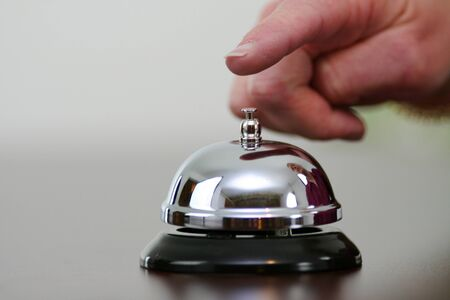 Hand ringing a bell for customer service Imagens