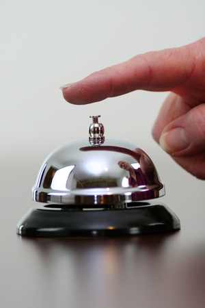 Hand ringing a bell for customer service 版權商用圖片