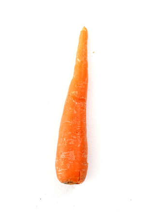 unpeeled: Single unpeeled carrot on white background Stock Photo