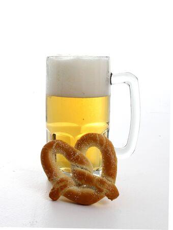 pretzel: Beer mug and pretzel on white background Stock Photo