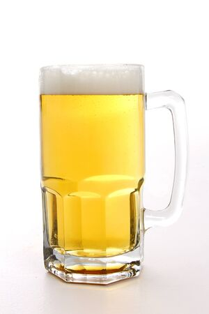 A tall mug of beer on white background
