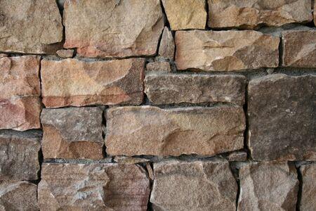 Bricks and stones make up a landscaping wall