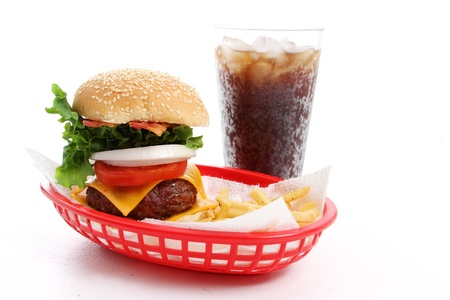 Meal of a cheesburger, fries, and a soda Standard-Bild