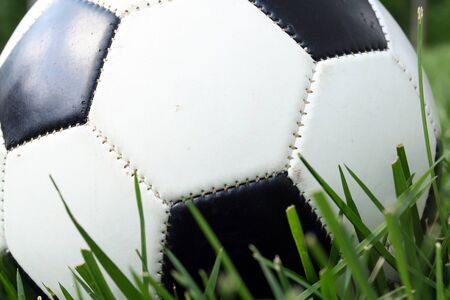 A soccerball sits on a field photo