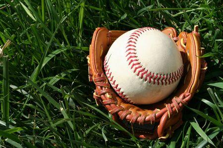 A baseball glove with a baseball