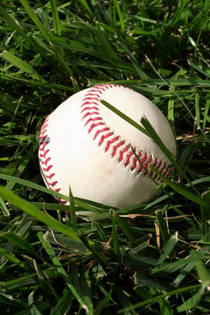 Baseball sitting on a field Stock Photo - 13147969