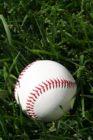 Baseball sitting on a field photo
