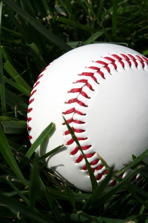 Baseball sitting on a field Stock Photo - 13139752