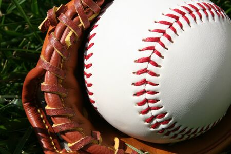 baseball stadium: A baseball glove with a baseball Stock Photo
