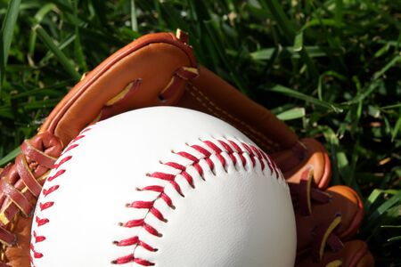 A baseball glove with a baseball photo