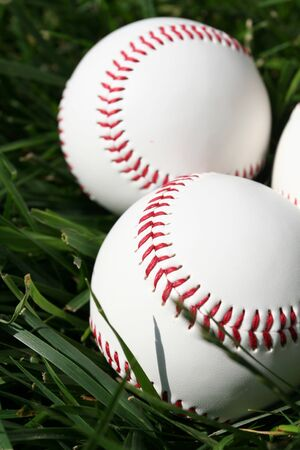 Baseballs sitting on a field Stock Photo - 13139555