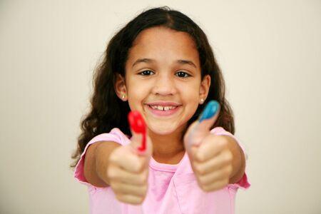 children painting: Girl at school finger painting