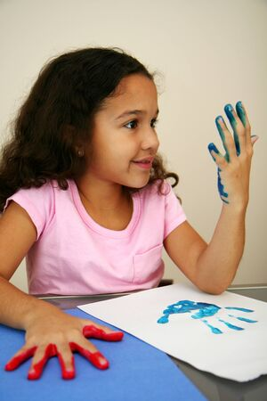 Girl at school finger painting Stock Photo - 13140129