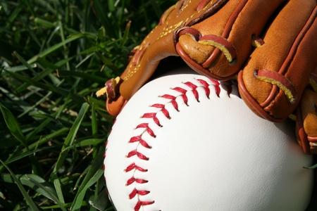 baseball diamond: A baseball glove with a baseball Stock Photo