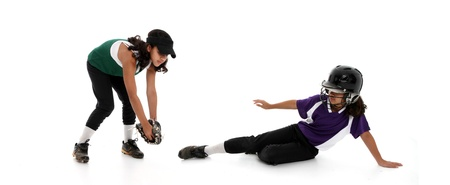 Playing the game of softball with a white background photo