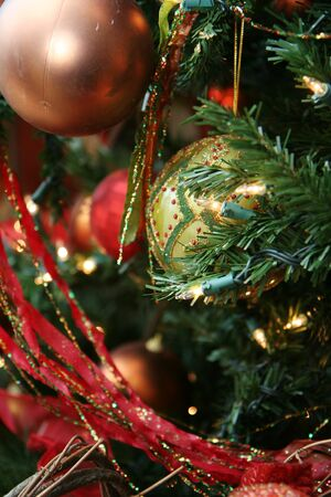 Luxuriously decoreated christmas tree filled with ornaments Stock Photo