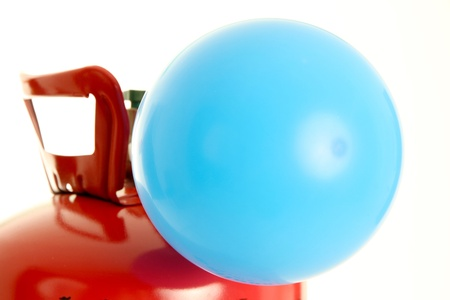 helium balloon: Balloon being filled up by a helium tank