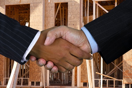 Business team shaking hands while closing a deal Stock Photo - 13142548